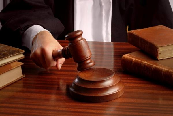 Если договор заключен, а недвижимость уже отошла новому хозяину, вопрос расторжения договора придется решать через суд