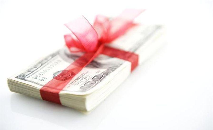 Облагается ли налогом премия и в каком порядке это происходит